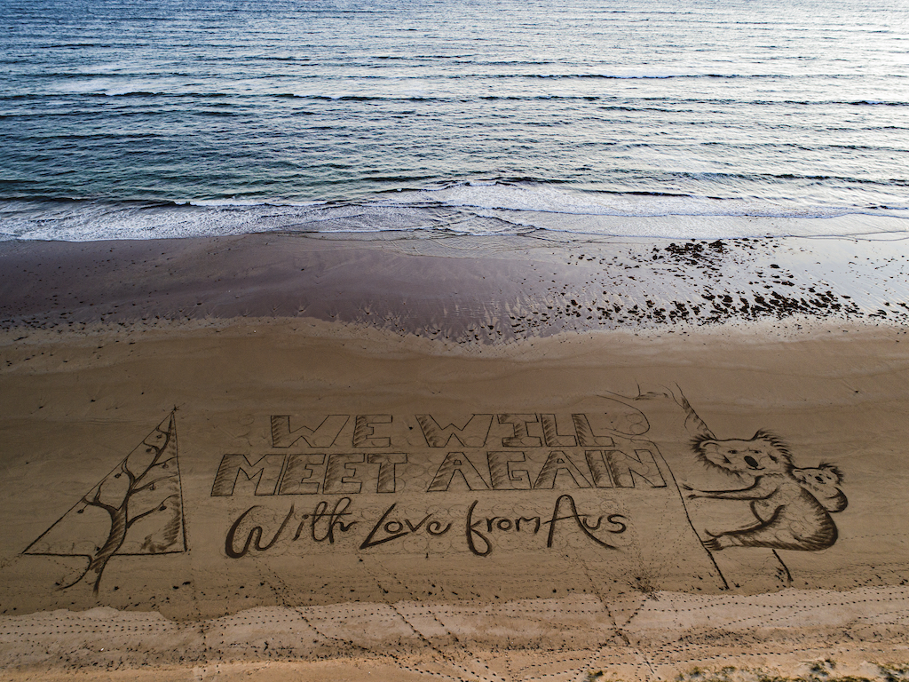 To UK with love! Giant Christmas message from Aussies to Brits etched into beach